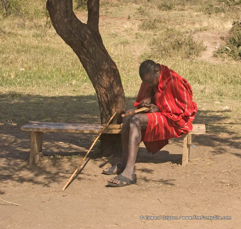 Masai carving in the shade